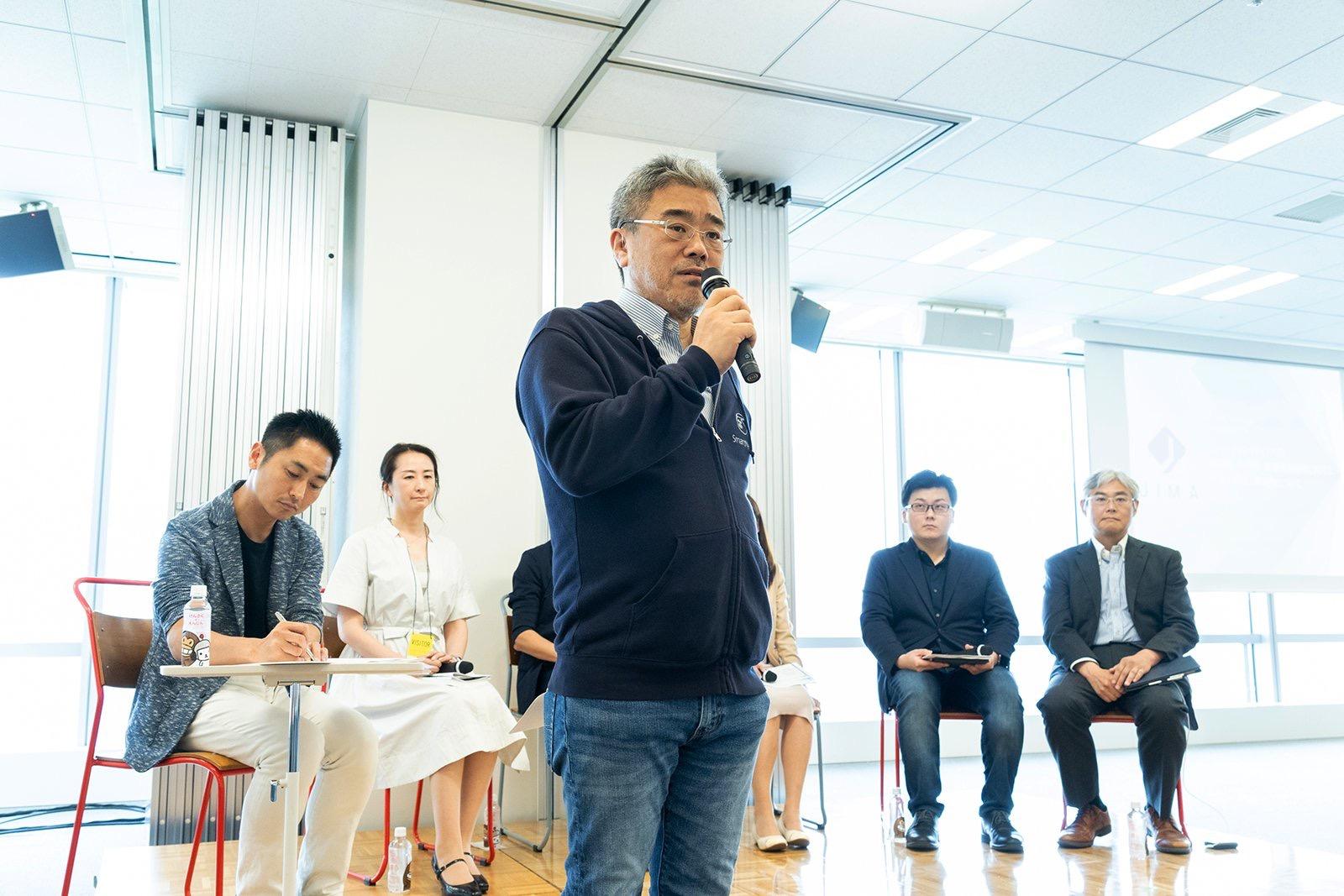 平場で議論ができる団体にと抱負を述べる代表理事の瀬尾傑 JIMAシンポジウム